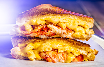 Enjoy delicious food items during Summer Nights at Busch Gardens Tampa Bay like a Lobster Mac N' Cheese Melt