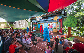 Families enjoy an entertaining show Let's Play Together at Sesame Street at Busch Gardens located in Tampa Florida
